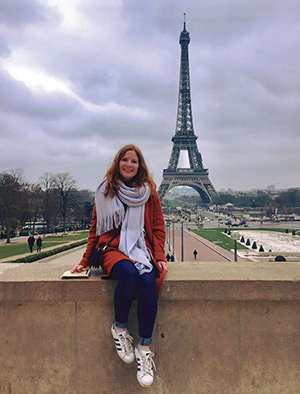 Hannah Swiatkowski posing, with the Eiffel Tower in the background
