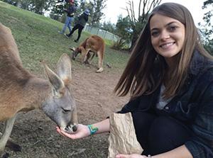 Maria Wagner feeding a kangaroo in Australia