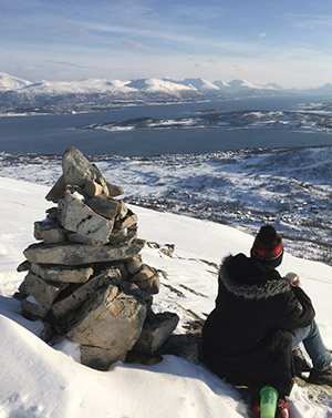 Bailey Nimmrichter admiring the scenery from atop a mountain in Norway