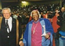 Archbishop Tutu dancing down the aisle